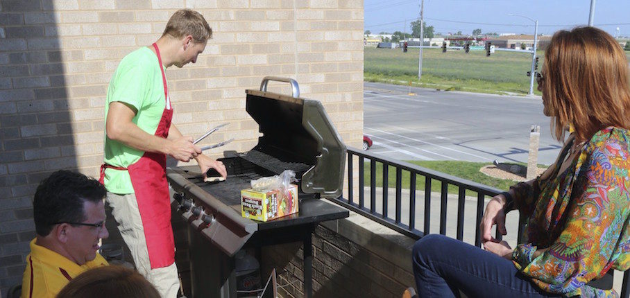 Carter grilling up some burgers for his teammates