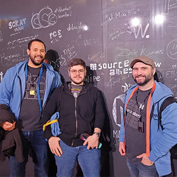 Three teammates posing for picture at AWS re:Invent 2019