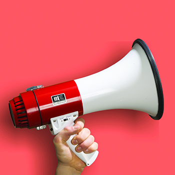 A megaphone held by a human hand