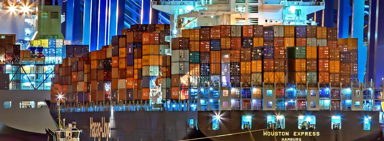 shipping containers on a boat at night