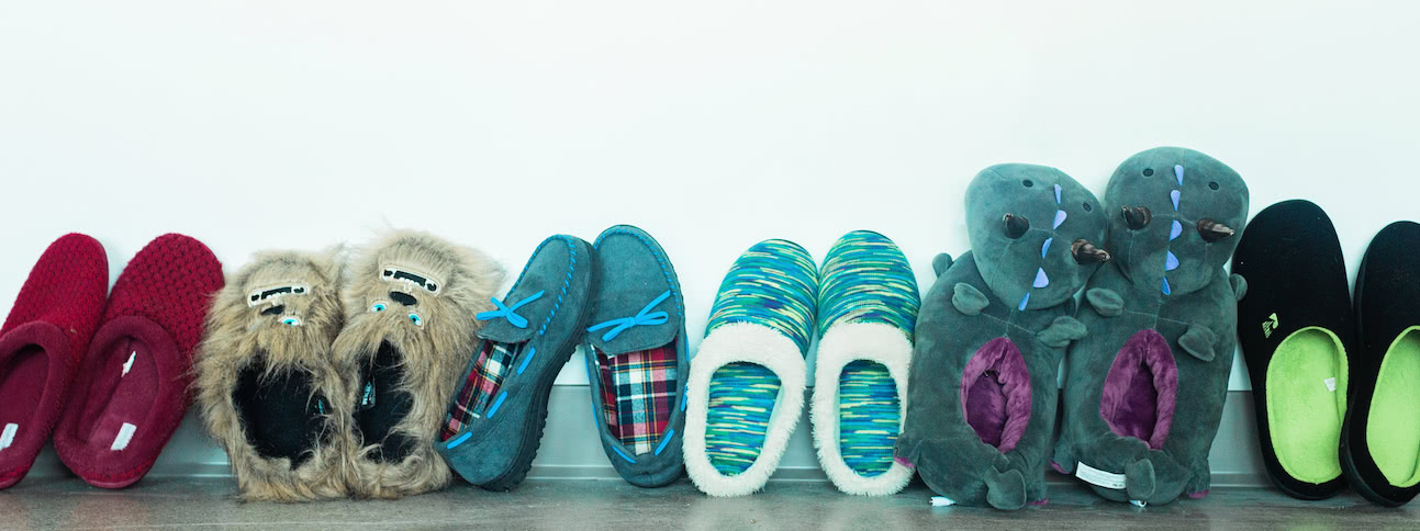Slippers lined up on a wall